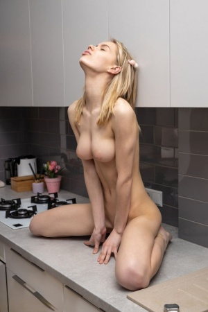 Young blonde Samara exposes her skinny body in the kitchen