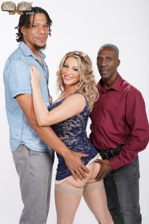 Blonde chick with wavy hair has sex with two black men at once