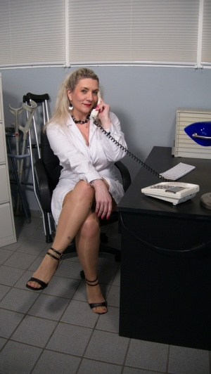 Fat older blonde removes a lab coat before hardcore sex with a younger man