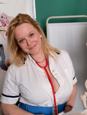 Fat nurse Sindy Bust slides her panties aside for pussy play on a hospital bed