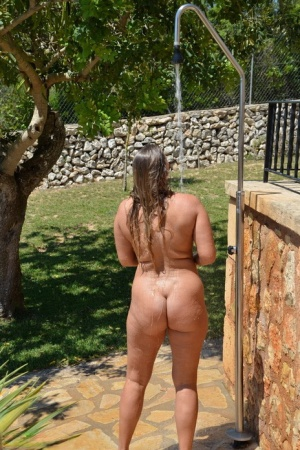 Chubby mature amateur Sweet Susi takes a shower out on the back lawn