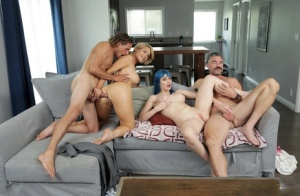 Close familial relations have group sex on a living room sofa