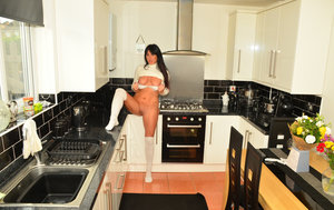 Sexy MILF Raunchy Raven gets naked in white OTK socks while in her kitchen