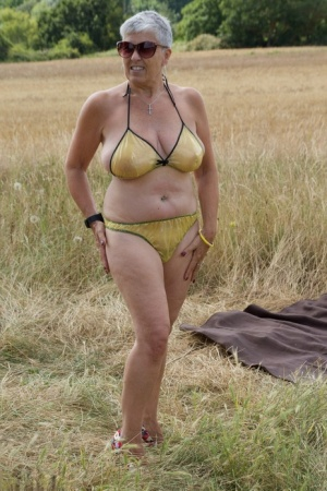 Old lesbians catch rays on their large breasts while sunbathing in a field 11846651