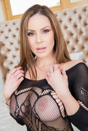 Busty MILF Kendra Lust removes a sexy bodystocking before riding a dick 38357755