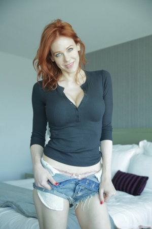 Older natural redhead Maitland Ward makes her nude debut during a solo gig