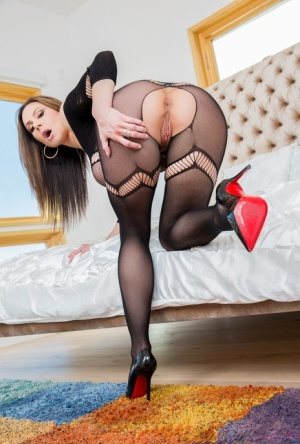 Curvy female Kendra Lust models a crotchless bodystocking before having sex 80652993