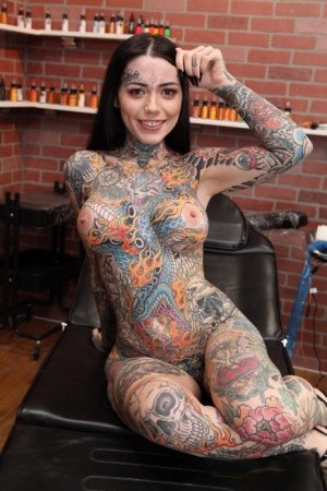 Heavily tattooed girl Tiger Lilly gets a new tattoo while completely naked 94033034