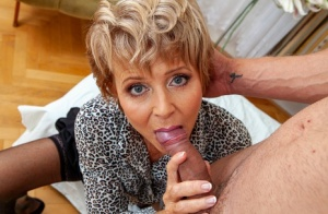 Old blonde woman takes an external cumshot after seducing a young man