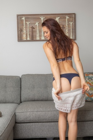 Redhead amateur Anya Stark shows her nice ass after stripping off her clothes