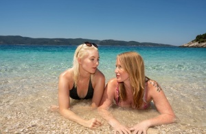 Older and younger women discover the joys of lesbian sex during a beach trip