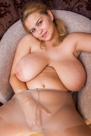 Solo girl Erin Star slips a hand down pantyhose after uncovering her knockers