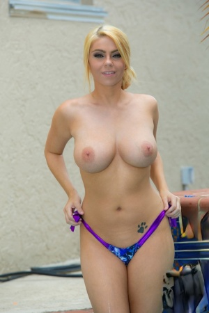 Blonde amateur Kylie K sets her great body free of a bikini next to a pool 80110725