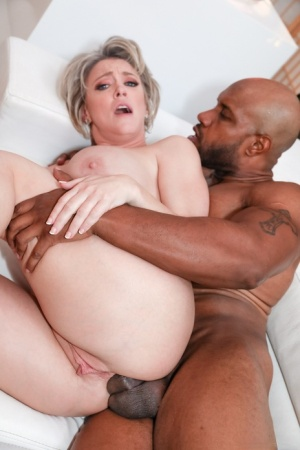 Busty blonde Dee Williams goes ass to mouth with a younger black man 83471619