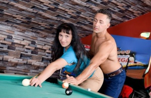 Dark haired woman and her man friend shoot pool before fucking on the table 94313806