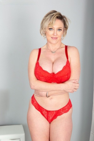 Busty housewife Dee Williams has her asshole toyed by an off-screen individual