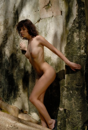 Brunette model Corail hits upon great nude poses in a derelict prison