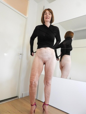 Caucasian grandmother Kat Kitty strips to her heels afore a mirror