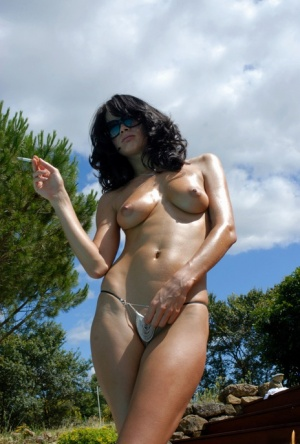 Glamour model Marie smokes outdoors in shades and a G-string 80914309