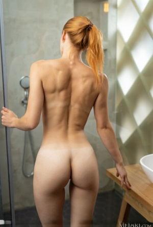 Skinny redhead Siiri douses her naked pussy in a milk while in a shower