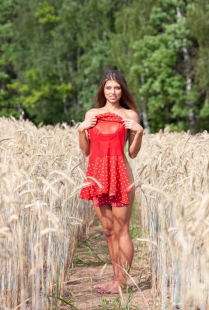 18 year old girl Valya strikes great nude poses between rows of wheat