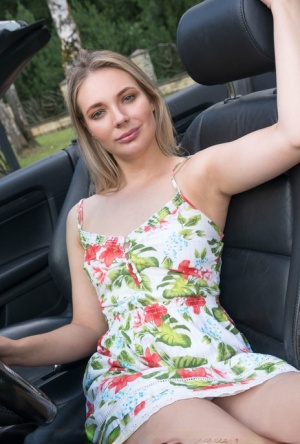Young blonde Maxine gets naked in a driveway next to a convertible