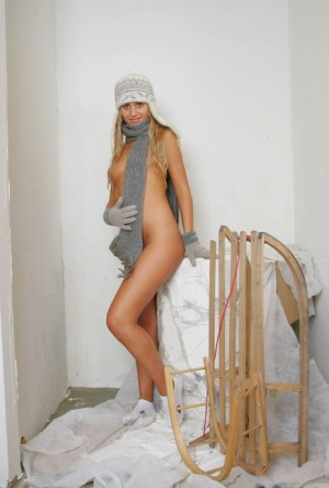 18-year-old blonde Lory doffs a toque scarf and gloves to pose nude in socks