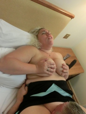 Busty older blonde Barby engages in oral sex with her husband on their bed