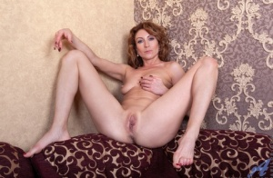 Amateur housewife Dafna May takes a selfie before getting completely naked