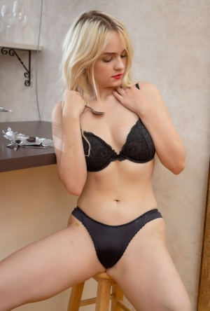Petite blonde Riya sports red lips while teasing her pink slit with a spoon
