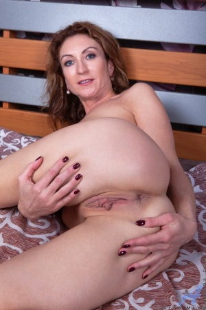 Amateur housewife Dafna May completely disrobes before masturbating with a toy