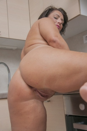 Overweight mature housewife gets naked for a finger fuck in her kitchen 66530441