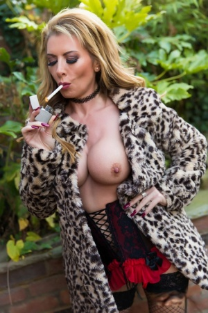 UK blonde Lynda Leigh lights a cigarette after exposing her tits on a deck 19570504
