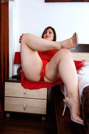 Overweight brunette Ivanna Lace looses her huge boobs from a red dress