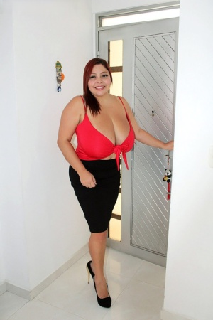 Thick Latina redhead Sofia Damon sets her massive breasts loose over some wine 43230631