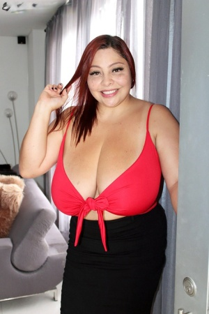 Thick Latina redhead Sofia Damon sets her massive breasts loose over some wine