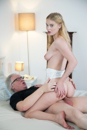 Young blonde sucks on an old mans cock before a vaginal fuck on a bed
