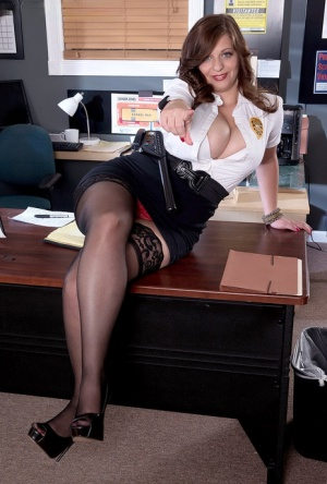 Overweight policewoman Jessica Roberts looses ample assets on a desk at work