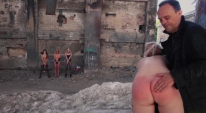 Young sex slaves are put through their paces in a dungeon setting by a man