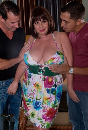 Big titted BBW Kris Kelly has sex on a bed with two guys at once