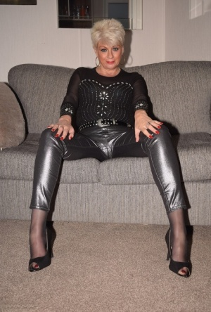 Sexy mature lady Dimonty removes black leather pants before showing her twat 91425007