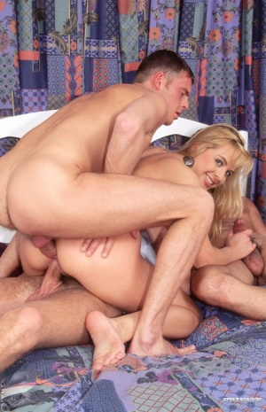 Blonde chick Megia does a Dp during the course of a hardcore gangbang