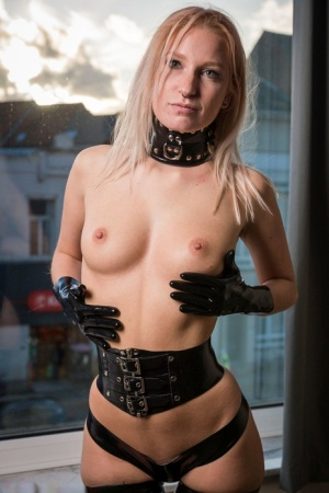 Collared blonde Arienh models topless in latex gloves and stockings