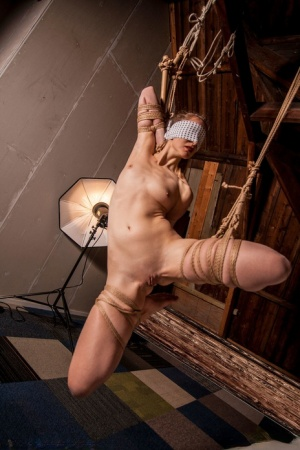 Naked white girl Dutch Bluebird is blindfolded before being suspended by rope
