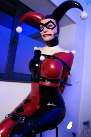 Solo model Dutch Dame sports a mouth spreader while in a rubber costume