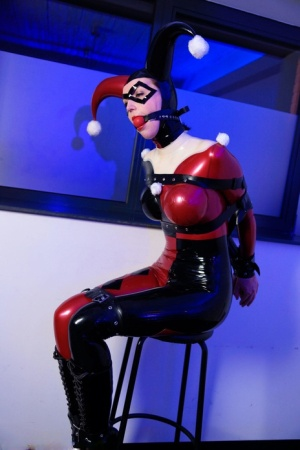 Solo model Dutch Dame sports a ball gag while restrained in a latex outfit