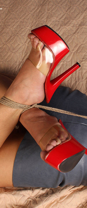 Solo girl is ball gagged and hogtied in a bra miniskirt and high heels