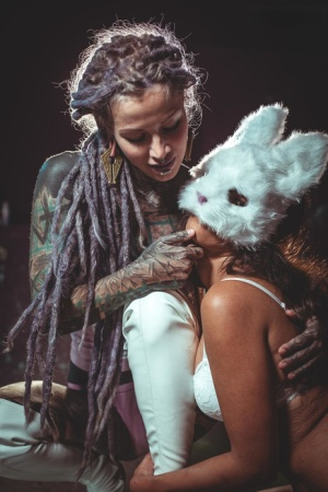 Tattooed chick suspends her lesbian lover after tying her up with ropes
