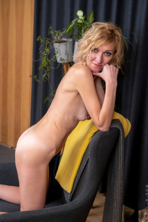 Blonde housewife Peggy puts her skinny body and pussy on display upon a chair