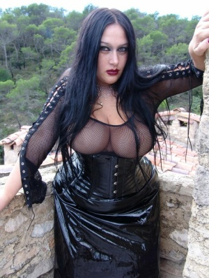 Thick brunette Lady Angelina loses her big boobs from rubber clothing